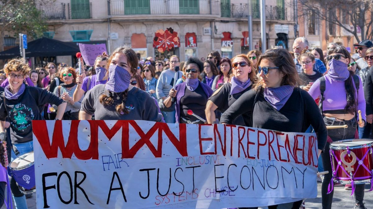 an image of women entrepreneurs and allies marching on international women's day 2020 in Toronto