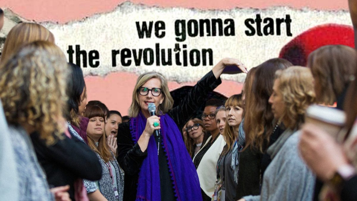 "An image of Vickie Saundersin a blue scarf holding a microphone surrounded by women, text behind her reads ""we are gonna start the revolution"""