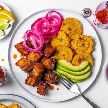 Chicharron, a Caribbean food with plantains, avocado, onion