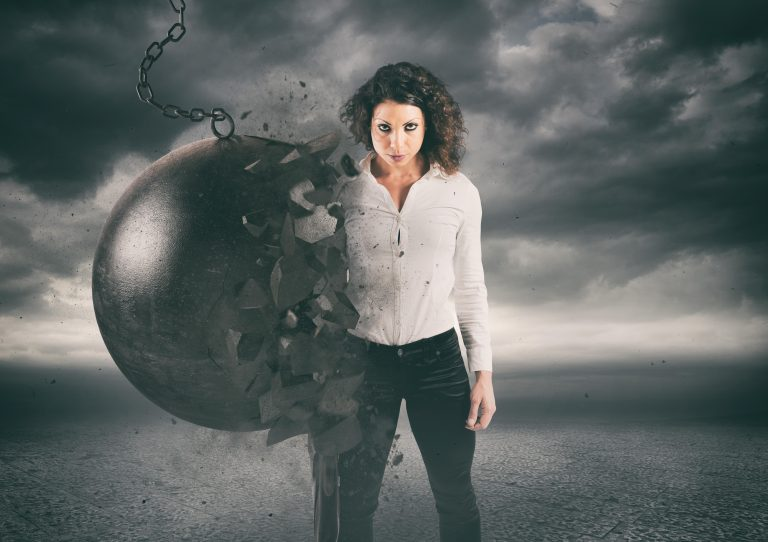 woman standing against a wrecking ball